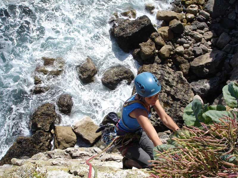 Letitia scaling the sea-cliffs in Pembroke